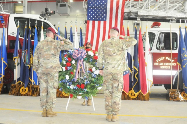 JRTC and Fort Polk Command Sgt. Maj. Michael C. Henry (left), Sgt. 1st Class Adriana S. Fox, JRTCOperations Group (center), and Brig. Gen. Patrick D. Frank, commander, JRTC and Fort Polk, place a wreath in memory of those killed in terrorist attacks on Sept. 11, 2001, during a 9-11 ceremony Sept. 11 at the Fort Polk Main Fire Station.