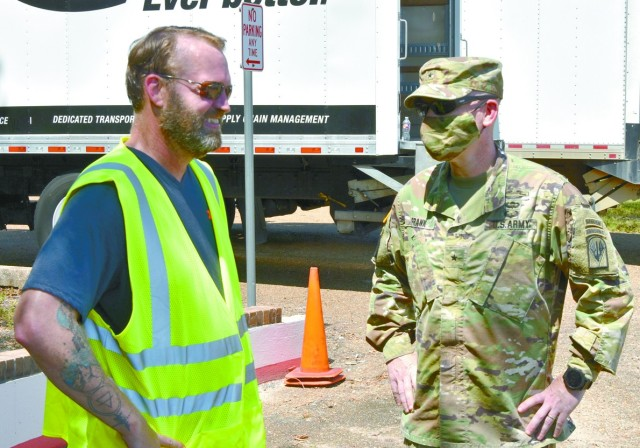 Michel E. Buterbaugh, Mobilization Program manager (left), visits with Brig. Gen. Patrick D. Frank, commander, Joint Readiness Training Center and Fort Polk, at a Red Cross distribution point at the installation's Siegfried Youth Activity Center. Buterbaugh was one of a host of volunteers who manned the point.