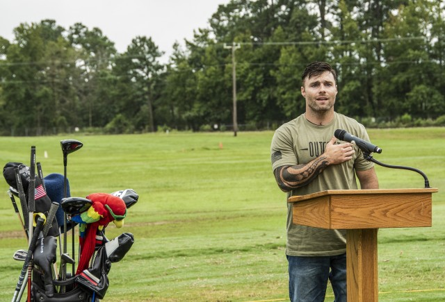 JP Lane, a U.S. Army veteran, performer, and double amputee, sings the National Anthem prior to T-off at a morale building golf scramble held at Fort Eustis, Va., Sept. 11, 2020. (U.S. Army photo by David Overson)