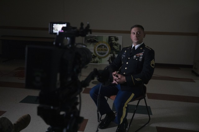 """Staff Sgt. Benjamin Latham, a U.S. Army Reserve combat engineer representing the 108th Training Command (Initial Entry Training), prepares for an interview following a presentation board during the 2020 U.S. Army Reserve Best Warrior Competition on Sept. 9, at Fort McCoy, Wisconsin. Approximately 50 Soldiers from across the nation travelled to compete in this year's Best Warrior, hosted from Sept. 4-10, 2020. The 2020 BWC is an annual competition that brings in the best Soldiers across the U.S. Army Reserve to earn the title of """"Best Warrior"""" among their peers. Competitors are evaluated on their individual ability to adapt and overcome challenging scenarios and battle-focused events, which test their technical and tactical abilities under stress and extreme fatigue. (U.S. Army Reserve photo by Spc. Zachary Johnson)"""