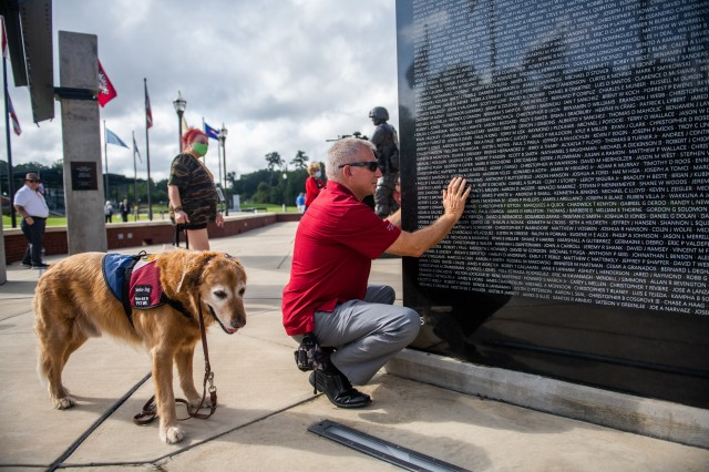 Kevin Graves touches his son's name, which is etched in the granite. The Global War on Terrorism Memorial was dedicated in October 2017. This was Graves' first trip to see the memorial and speak at a dinner for nearly 100 Gold Star families. He joined the Fort Benning community for the rededication of the Global War on Terrorism Memorial Sept. 12 at the National Infantry Museum. The memorial was dedicated in October 2017. (U.S. Army photo by Patrick A. Albright, Maneuver Center of Excellence and Fort Benning Public Affairs)
