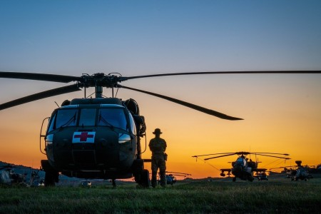Army medics prepare helicopters for a mission during Saber Junction at Hohenfels Training Area, Germany, Aug. 7, 2020. The joint exercise is designed to assess readiness and promote interoperability with allied and partner nations.
