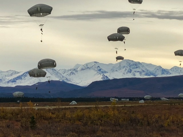"""Paratroopers from the 4th Brigade Combat Team (Airborne), 25th Infantry Division, """"Spartan Brigade,"""" execute a joint forcible entry operation into Donnelly Training Area, Alaska, Sept. 14, 2020. More than 250 Paratroopers participated as part of a U.S. Army Pacific exercise that included the movement of an M142 High Mobility Artillery Rocket System from the 17th Fires Brigade based at Joint Base Lewis-McChord to Shemya Island, along with air support from Joint Base Elmendorf-Richardson F-22 fighter jets. The exercise demonstrated the capability of U.S. military forces in the Pacific theater to work together across vast distances to project force as needed to bolster safety and stability in the region. (Photo courtesy of U.S. Army Pfc. Colton Eller, Comanche Co., 1st Battalion, 501st Parachute Infantry Regiment, 4th Infantry Brigade Combat Team (Airborne), 25th Infantry Division)"""