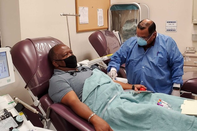 Richard Rangel, medical laboratory technician, prepares Thefety Tibbs, who was among the first donors of convalescent plasma, for his first convalescent plasma donation in June 2020 at the Akeroyd Blood Donor Center on Joint Base San Antonio Fort Sam Houston. The Armed Services Blood Program is accepting convalescent plasma donations at the Akeroyd center for use by Brooke Army Medical Center as a potential treatment for COVID-19.