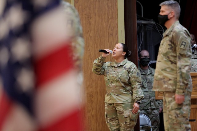 "Staff Sgt. Natalie Romero, 5th Armored Brigade, sings the National Anthem during a Transfer of Authority ceremony at Fort Bliss, Texas, September 11, 2020. The 85th U.S. Army Reserve Support Command's 1st Battalion, 338 Regiment, assumed the CONUS Replacement Center mission, supporting as 5th Armored Brigade's ""Viper 9"", the ninth rotation serving in this mission. The 94th Training Division's 8th Battalion, 108th Regiment bid farewell during the ceremony as ""Viper 8"" to close out their rotation. The CRC mission is to take care of Soldiers, DA Civilians and contractors that go through the mobilization process, individually, ahead of overseas deployments and assignments. This was the first unit assigned to the 85th USARSC to mobilize for this effort after receiving the mission from Army Reserve Command. (U.S. Army Reserve photo by Master Sgt. Anthony L. Taylor)"