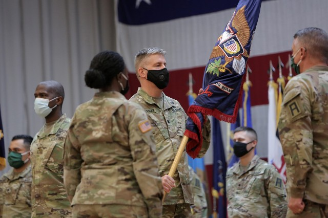 "Lt. Col. Brian Wojtasiak, Commander of ""Viper 9"" and the CONUS Replacement Center, receives the Colors during a Transfer of Authority ceremony at Fort Bliss, Texas, September 11, 2020. The 85th U.S. Army Reserve Support Command's 1st Battalion, 338 Regiment, assumed the CRC mission, supporting as 5th Armored Brigade's ""Viper 9"", the ninth rotation serving in this mission. The 94th Training Division's 8th Battalion, 108th Regiment bid farewell during the ceremony as ""Viper 8"" to close out their rotation. The CRC mission is to take care of Soldiers, DA Civilians and contractors that go through the mobilization process, individually, ahead of overseas deployments and assignments. This was the first unit assigned to the 85th USARSC to mobilize for this effort after receiving the mission from Army Reserve Command. (U.S. Army Reserve photo by Master Sgt. Anthony L. Taylor)"