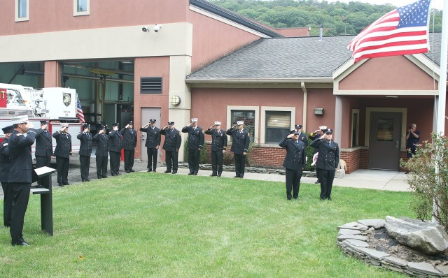 "Eighteen current and former members of the West Point Fire Department take part in a memorial ceremony Friday to honor the 343 firefighters, including a former WPFD firefighter Richard ""Bruce"" Van Hine, who died during the Sept. 11, 2001, terrorist attacks on the Twin Towers in New York City."
