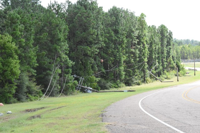 Downed power lines litter the roadside leading to Polk Army Air Field.