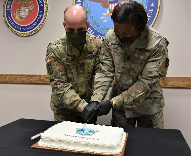 Deputy Commander Col. Timothy Walsh and Sgt. Maj. Danyell Walters cut a cake to mark the first anniversary of U.S. Army Medical Logistics Command. AMLC was officially activated Sept. 17, 2019 as the Army's primary medical logistics and sustainment command, responsible for managing the global supply chain and medical materiel readiness across the total force.