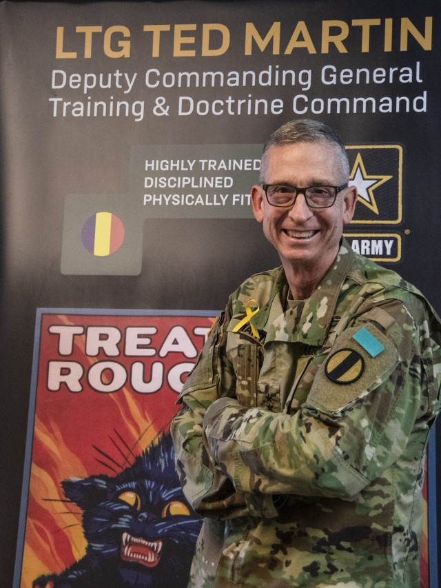 Lt. Gen. Ted Martin, Deputy Commanding General of the U.S. Army Training and Doctrine Command, poses with his SASH (Soldiers Against Sexual Assault / Harassment) tab, along with his yellow ribbon to bring awareness to the SASH program and Worldwide Suicide Awareness Day, at TRADOC Headquarters, Fort Eustis, Va., Sept. 10, 2020.  (Army photo by David Overson)