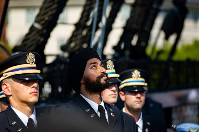 Kanwar Singh silently prays before his commissioning ceremony aboard the USS Constitution in August 2018. Singh, a practicing Sikh and native of New Dehli, enlisted in the Army to attend officer candidate school in Massachusetts in 2015, but had to file for a religious accommodation to continue serving while practicing his faith.