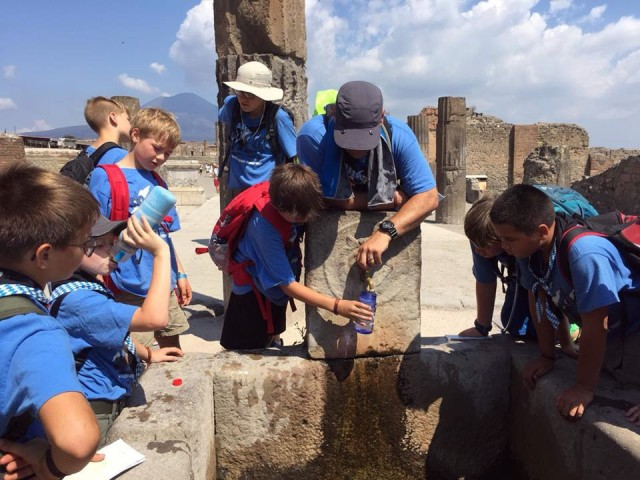 Lt. Col. Joel Gleason, center, commander of U.S. Army Garrison Okinawa and Scoutmaster of Boy Scout Troop 101 in Okinawa, helps scouts from Troop 261 on a week-long camp in Italy fill their water bottles at a reconstructed ancient fountain in Pompeii in July 2018. Gleason was the troop's assistant Scoutmaster.