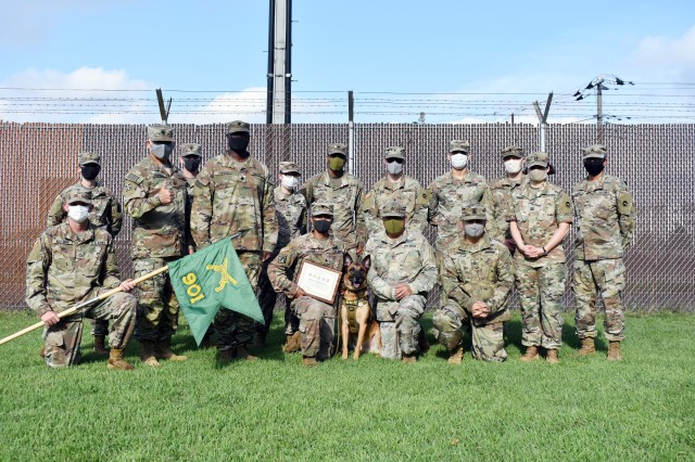 Members of the 901st Military Police Detachment, Lt. Col. Demetrick Thomas and Command Sgt. Maj. Edgar Rodriguez, command team of the 35th Combat Sustainment Support Battalion, as well as Soldiers from the Camp Zama Veterinary Treatment Facility, pose for a photo with Sgt. 1st Class Vito during Vito's retirement ceremony at Camp Zama, Japan, Sept. 17.