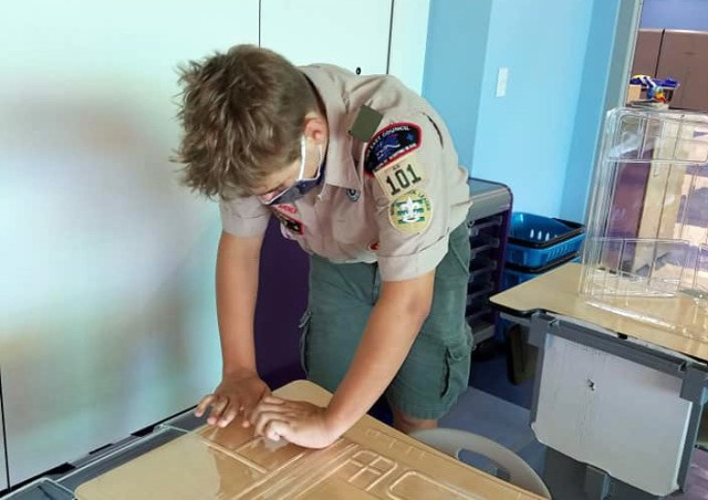 Colton Gleason prepares plastic barriers for Zukeran Elementary School in Camp Foster, Okinawa, in August, to enable schools to open for COVID-19. He also organized and led volunteers to set up the barriers.