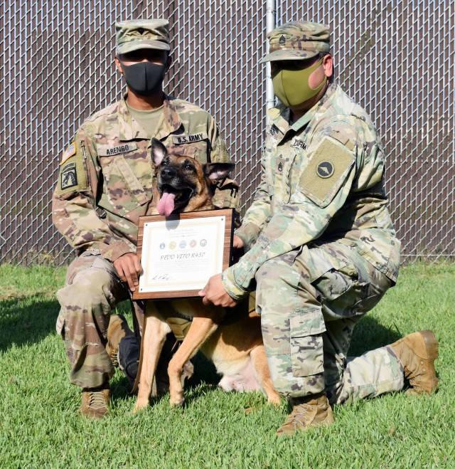 Spc. Jericho Arengo, left, and Staff Sgt. Antonio Razo, right, assigned to the 901st Military Police Detachment, pose for a photo with Sgt. 1st Class Vito, during Vito's retirement ceremony at Camp Zama, Japan, Sept. 17.