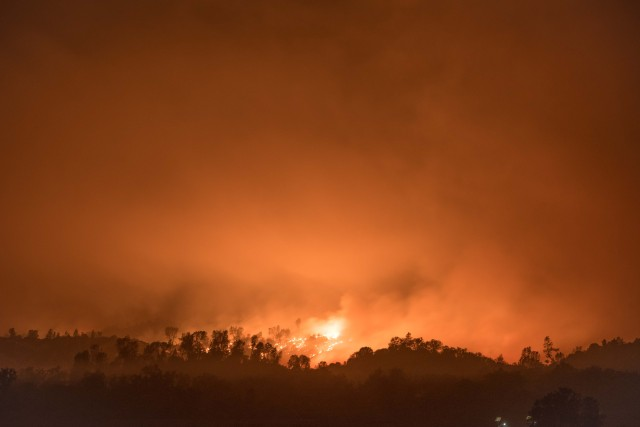 Fort Hunter Liggett conducted a backburn along Del Venturi Road to prevent the Dolan Fire from spreading to the cantonment area. This was the evening view from the post residential areas, Sept. 8, 2020. Photo by Jacob Daly, DPW.
