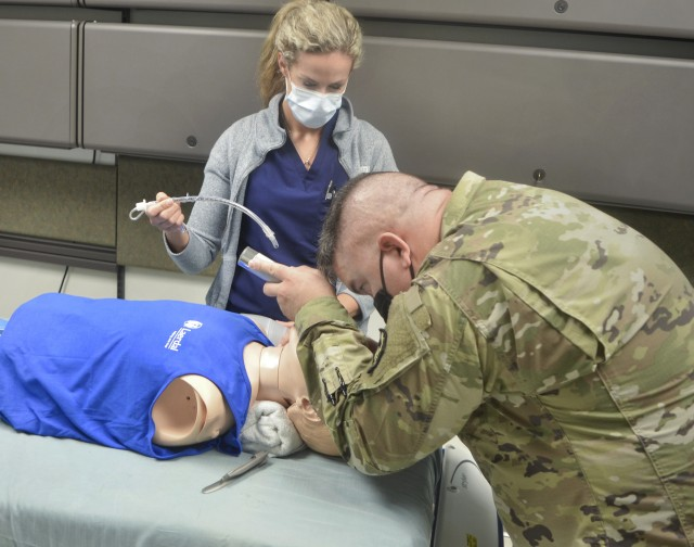 Lt. Col. Garrett Meyers, chief of Department of Family and Community Medicine, practices intubating a patient during Individual Critical Task List training at the CRDAMC simulation lab August 21. The realistic, standards-based readiness training allows CRDAMC medical personnel working in garrison to maintain and exceed proficiency in combat casualty care skills needed to care for wounded service members while deployed overseas.