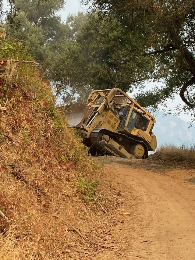 Fort Hunter Liggett Public Works and Army Reserve engineers from the 102nd Training Division TASS Training Center – FHL providing bulldozers and drivers to widen existing fire breaks and building new ones along the post perimeter. (Courtesy photo)