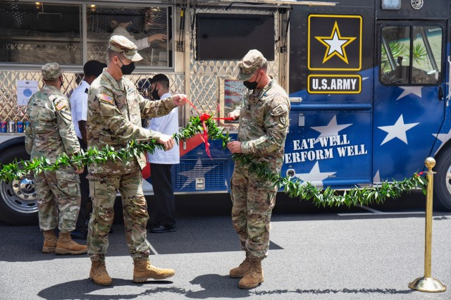 Maj. Gen. James Jarrard, 25th Infantry Division commanding general, Command Sgt. Maj. William Pouliot, division sergeant major, untie a lei in front of The Culinary Outpost for the truck's grand opening Sept. 3 at Schofield Barracks.