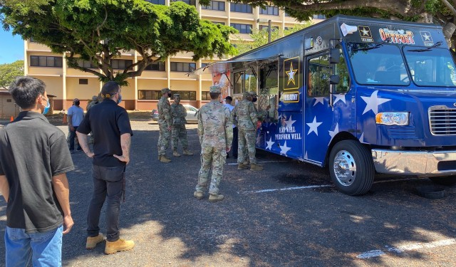 Soldiers and civilians practice social distancing while waiting to place their order at The Culinary Outpost. The food truck is capable of serving up to 200 people per meal period.