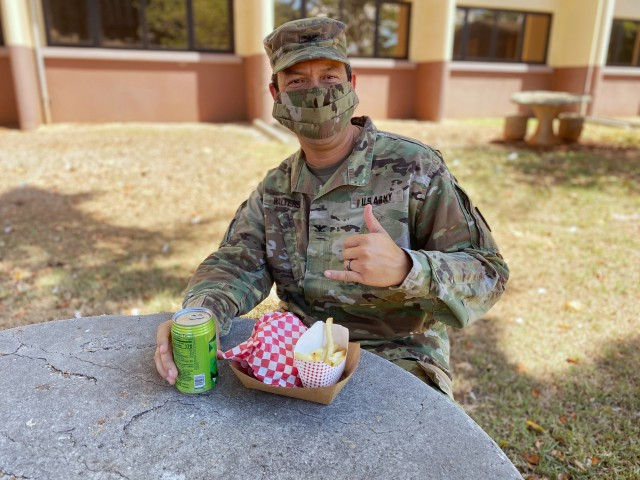 402nd AFSB commander Col. Anthony Walters enjoys his first taste of The Culinary Outpost.