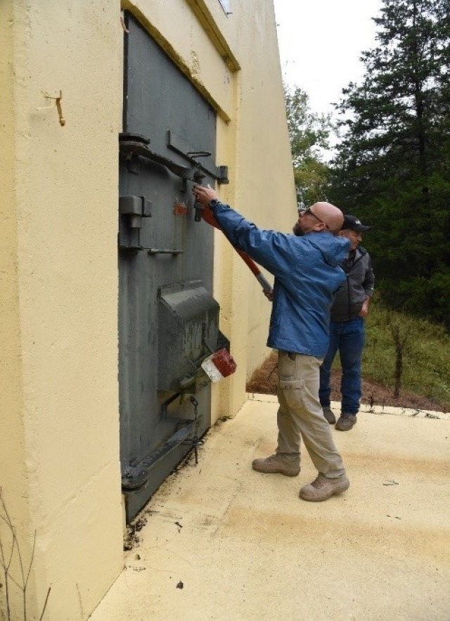 MARID Program Coordinator, Wade McMath, opens a munitions magazine during a recent mission