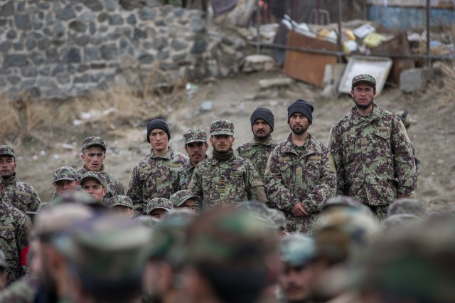 Afghan National Army trainees stand while waiting to be greeted by Afghan Minister of Defense Asadullah Khalid, Deputy Defense Minister Dr. Yasin Zia and Resolute Support Commander Gen. Scott Miller in Kabul, Afghanistan, March 5, 2020. Resolute Support is a NATO-led (North Atlantic Treaty Organization) mission to train, advise, and assist the Afghan National Defense and Security Forces and institutions. (U.S. Army Reserve photo by Spc. Jeffery J. Harris/Released)