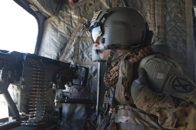 A crew member assigned to the scans his sector while providing security during a flight aboard a CH-47 Chinook helicopter during a fly-to-advise mission Dec. 14 in Southeastern Afghanistan. The 10th CAB provided air support for Afghan Soldiers assigned to the 203rd Thunder Corps, Afghan National Army, and U.S. Soldiers assigned to the Headquarters and Headquarters Battalion, 1st Armored Division to conduct battlefield circulation in support of Operation Freedom's Sentinel and Operation Resolute Support (RS). Resolute Support is a NATO-led mission to train, advise and assist the Afghan National Defense and Security Forces (ANDSF) and institutions.