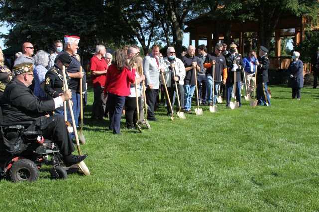 """Gold Star Family members prepare for a """"first sod-turning"""" during a monument groundbreaking ceremony held Sept. 17 on the grounds of the Clinton Township Administration complex. The monument, planned to be completed in later 2021, will honor southeastern Michigan Gold Star Family members."""