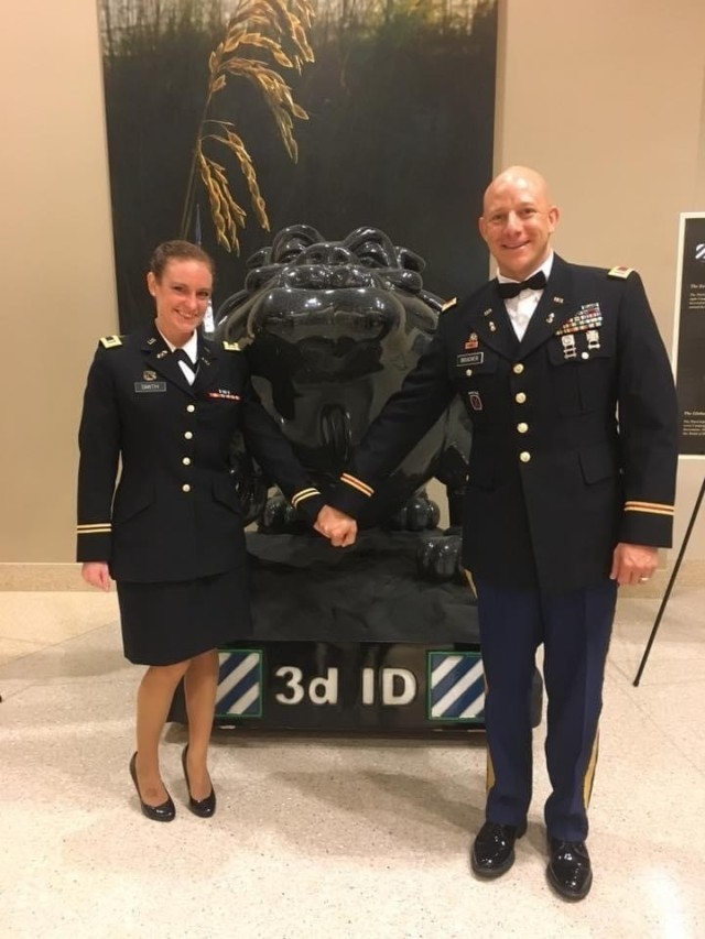 Dr. Kristen Boucher poses with her husband Jeremy Boucher in uniform at a military ball in 2017. Kristen, a Syracuse, New York native, and Jeremy, a Springfield, Massachusetts-native, have both since retired from the Army. The couple opened Split Fin Brewing in Midway, Ga., in June 2020, and credits much of their business' success to the skills they gained while serving in the Army.