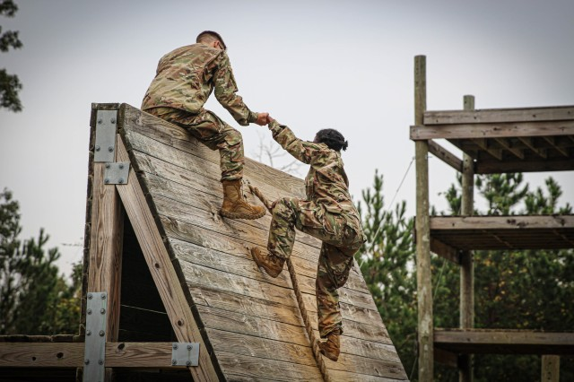 The Army looks to foster an equitable and inclusive environment that facilitates building diverse, adaptive, and cohesive teams. Pictured are cadets with Auburn University Army Reserve Officer Training Corps and Tuskegee University Army ROTC programs working together to conquer an obstacle course during their training exercise at Fort Benning, Ga., on Sept. 18, 2020.