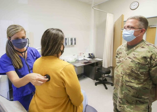 (Left) Natalie Svendsen, a student participating in Landstuhl Regional Medical Center's College Practicum Program, listens for abnormalities in a patient while U.S. Army Lt. Col. Kenneth Ford, officer in charge, Family Medicine Clinic, precepts, as part of Svendsen's clinical rotations toward her Master of Science in Nursing as a Family Nurse Practitioner, at LRMC's Family Medicine Clinic, Sept. 14.