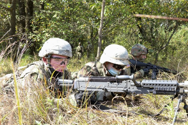 Cadet Thomas Rudrud, left, an MS2 with the Marquette ROTC Battalion, and Cadet Andrew Hruz, an MS3 with Marquette ROTC Battalion, provide cover during tactical training at Fort McCoy, Wis., Sept. 25, 2020. The cadets are conducting training to prepare for upcoming competitions and leadership events through their ROTC programs.