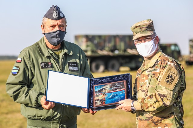 Brig. Gen. Gregory Brady the Commanding General of the 10th Army Air and Missile Defense Command exchanging gifts with Lt. Gen. Jan Sliwka, Deputy Commander of Polish Armed Forces during exercise Astral Knight 20 at Szymany Air Base, Poland, Sept. 22, 2020. Astral Knight 20 is a joint, multinational exercise involving Soldiers and Airmen from the United States working with service members from Poland, Latvia, Lithuania, Estonia, and Sweden. (U.S. Army photo by Capt. Rachel Skalisky)