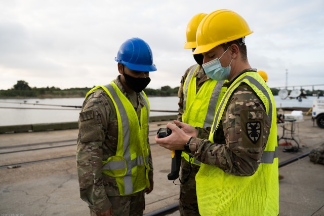 U.S. Army Spc. Michael Voss, a Transportation Management Coordinator (88N) with 368th Seaport Operations Company, 11th Transportation Battalion, 7th Transportation Brigade (Expeditionary) demonstrates troubleshooting methods for the Radio Frequency Identification (RFID) Scanner in Port Arthur, Texas, Sept. 25, 2020. The Joint Readiness Exercise allows the U.S. Army to assess the unit's alert and recall procedures, pre-deployment processes and transportation of personnel and equipment.   (U.S. Army photo by Sgt. Marygian Barnes, 22nd Mobile Public Affairs Detachment)