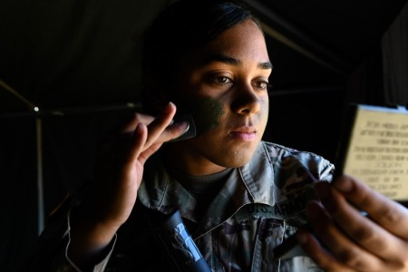 U.S. Army Spc. Tynina Williams applies face paint prior to mission during the U.S. Army Europe European Best Warrior Competition at U.S. Army Garrison Hohenfels Training Area, Germany, July 29, 2020.