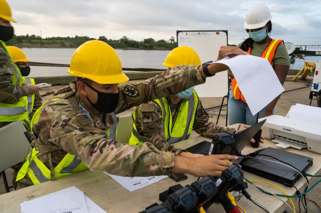 U.S. Army Pvt. Christian Dejesus, a Cargo Specialist (88H) with 368th Seaport Operations Company, 11th Transportation Battalion, 7th Transportation Brigade (Expeditionary), arranges equipment Radio Frequency Identification (RFID) tags in Port Arthur, Texas, Sept. 25, 2020. 2nd Brigade Combat Team, 25th Infantry Division deploys/redeploys from Schofield Barracks, Hawaii to the Joint Readiness Training Center (JRTC), Fort Polk, La., using air and ship modes of transportation.  (U.S. Army photo by Sgt. Marygian Barnes, 22nd Mobile Public Affairs Detachment)