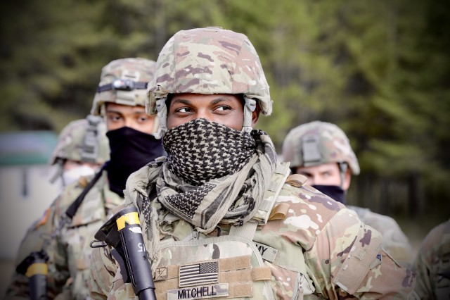 Army Reserve Spc. Javiere Mitchell, a chemical, biological, radiological and nuclear specialist and former outside linebacker for the Auburn College football team, assigned to 1st Platoon, 318th Chemical Company, 490th Chemical Battalion, 209th Regional Support Group, 76th Operational Response Command, stands in a company formation at Fort McCoy, Wis. Sept. 19. Mitchell and his unit are currently conducting a wide-variety of CBRN training at Fort McCoy, as part of Operation Desert Dragon, a two-week exercise designed to test the unit's specialized capabilities in a variety of scenarios as they prepare for an upcoming deployment.