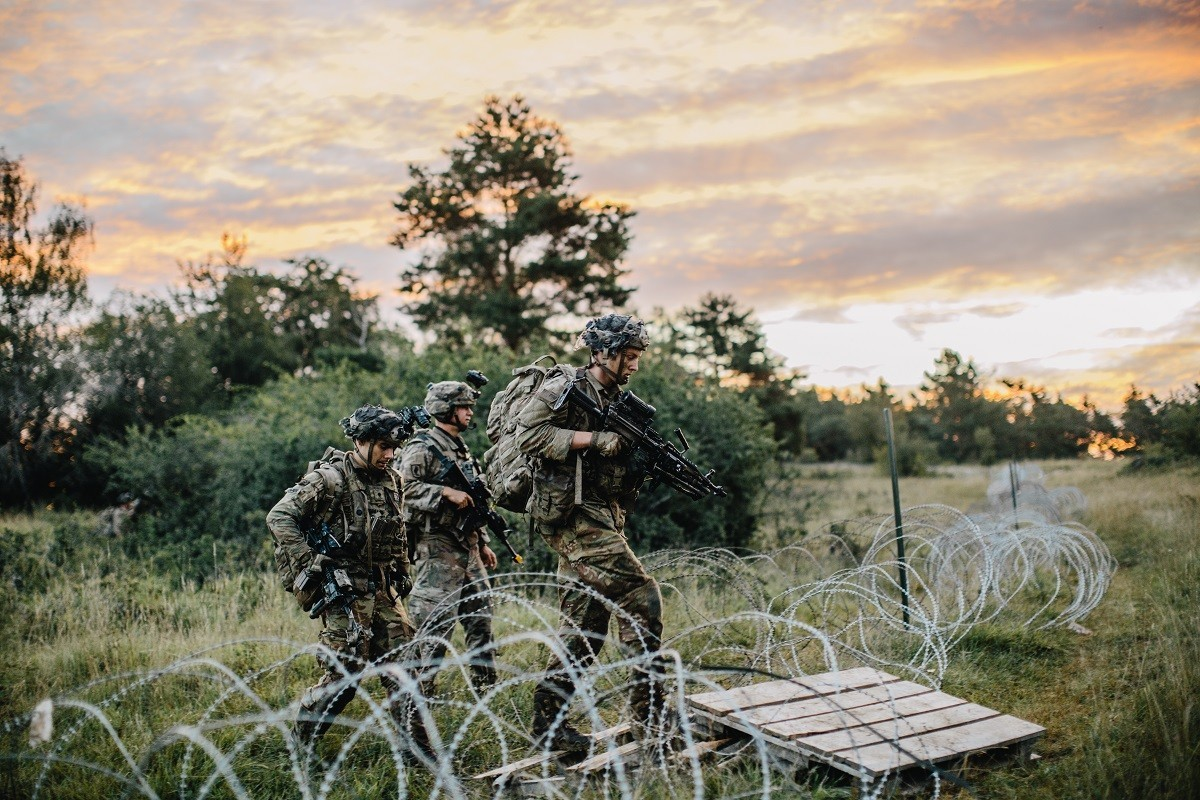 U.S. Army paratroopers cross over concertina wire during the assault of a city in Hohenfels Training Area, Germany, Aug. 20, 2020 during Exercise Saber Junction 20.