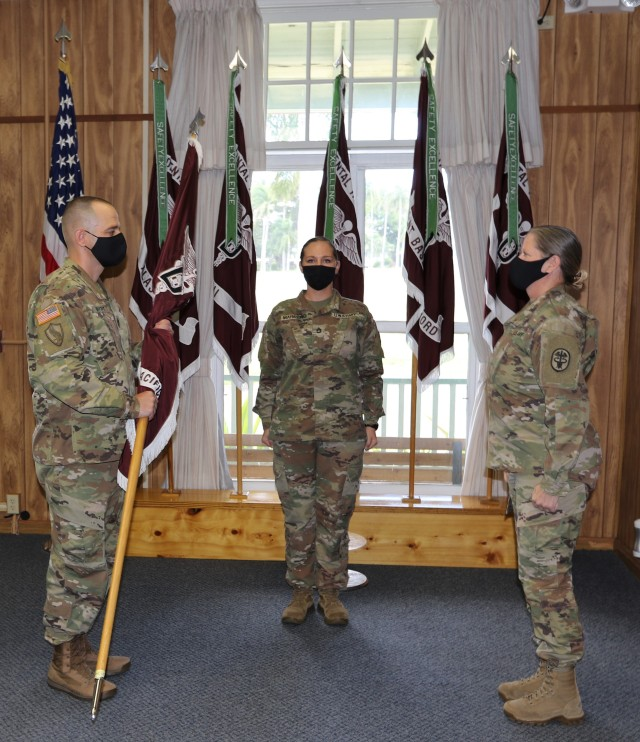Sgt. Maj. John Wright holds the unit colors during Dental Health Command-Pacific's assumption of command, Sept. 24. From left to right: Sgt. Maj. Wright, Sgt. 1st Class Melanie Marrero and Col. Kelley Tomsett.