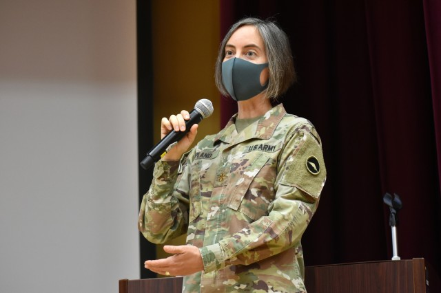 Maj. Dawn Opland, planner for U.S. Army Reserve Affairs Japan, U.S. Army Japan, speaks during the Japan Ground Self-Defense Force Reserve Interpreters Training symposium at Camp Zama, Japan, Sept. 24, an event she helped organize.