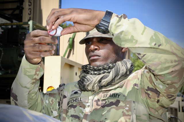 Army Reserve Spc. Javiere Mitchell, a chemical, biological, radiological and nuclear specialist and former outside linebacker for the Auburn College football team, assigned to 1st Platoon, 318th Chemical Company, 490th Chemical Battalion, 209th Regional Support Group, 76th Operational Response Command, prepares thread to sew up some gear at Fort McCoy, Wis. Sept. 19. Mitchell and his unit are currently conducting a wide-variety of CBRN training at Fort McCoy, as part of Operation Desert Dragon, a two-week exercise designed to test the unit's specialized capabilities in a variety of scenarios as they prepare for an upcoming deployment.