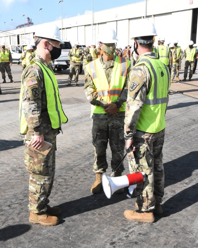 Brig. Gen. Patrick D. Frank, commander, JRTC and Fort Polk (left) and Lt. Gen. Leopoldo Quintas Jr., FORSCOM deputy commanding general (center) are briefed by Capt. Jordan Jendersee, commander, 366th Seaport Operations Company, 7th Transportation Brigade, at Port Arthur, Texas, Sept. 26 during offloading operations for Joint Readiness Exercise 20. The vehicles and equipment offloaded during the exercise were convoyed to Fort Polk for use by the 2nd BCT, 25th Inf Div during JRTC Rotation 21-01.