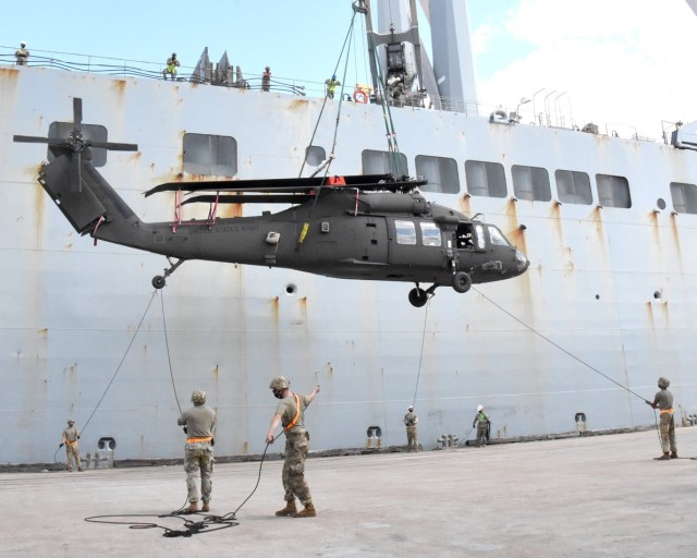 Soldiers with the 2nd Aviation Battalion, 25th Aviation Regiment, offload a helicopter at the Port of Beaumont, Texas, Sept. 26 as part of Joint Readiness Exercise 20. The helicopters will be flown to the Joint Readiness Training Center and Fort Polk for use by the 2nd Brigade Combat Team, 25th Infantry Division, during JRTC Rotation 21-01 in October.