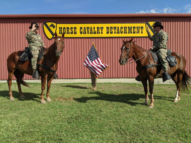 Staff Sgt. Randall Peaslee, career counselor, 1st Cavarly Division, re-enlists during a ceremony July 30 at the Horse Cavalry Detachment on Fort Hood. Headquarters, Department of the Army announced Oct. 5 that the 1st Cavalry Division placed number one in the Army in Retention rates for fiscal year 20. More than 5,480 Soldier in the division re-enlisted to continue to serve in the Army.
