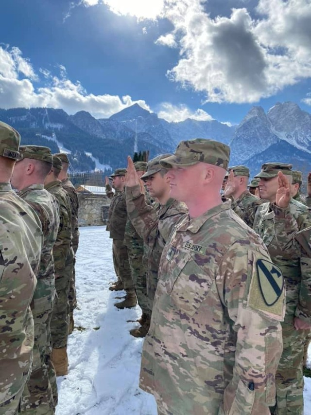 Soldiers from 1st Battalion, 8th Cavalry Regiment, 2nd Armored Brigade Combat Team, re-enlist Feb. 28, in Garmisch, Germany. Headquarters, Department of the Army announced Oct. 5 that the 1st Cavalry Division placed number one in the Army in Retention rates for fiscal year 20. More than 5,480 Soldier in the division re-enlisted to continue to serve in the Army.