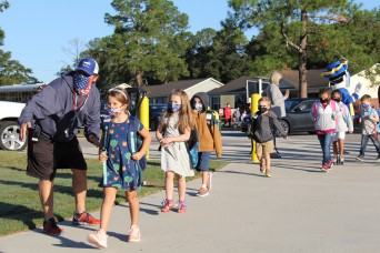 GOOSE BUMPS -- Students enter new Parker Elementary School for in-person learning for 1st time