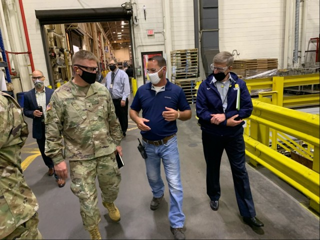 Brig. Gen. Darren Werner (left), commanding general Tank-automotive and Armaments Command, and Timothy Goddette (right), Program Executive Officer Combat Support and Combat Service Support, tour the facilities at Rock Island Arsenal Joint Manufacturing and Technology Center August 4.  They were briefed on some current initiatives at the arsenal to include Additive Manufacturing and the production of the High Mobility Multipurpose Wheeled Vehicle Ambulance Program.