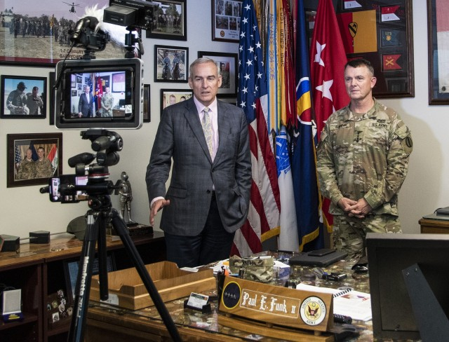 Dr. E. Casey Wardynski, Assistant Secretary of the Army for Manpower and Reserve Affairs (left), along with Gen. Paul E. Funk II, Commanding General, U.S. Army Training and Doctrine Command, record a public service announcement prior to a scheduled meeting to discuss operationalizing the Army's People Strategy for a ready and resilient force at TRADOC Headquarters, Fort Eustis, VA, Oct. 1, 2020. (U.S. Army photo by David Overson)