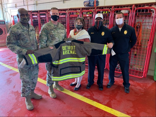 Two members of the Detroit Arsenal Fire Department pose with Command Sgt. Maj. Jerry Charles, Tank-automotive and Armaments Command, Brig. Gen. Darren Werner, commanding general TACOM, and Carrie Mead, Detroit Arsenal Garrison Manager.  The three were also given a tour of the facility and briefed on upcoming details for Fire Prevention Week 2020 currently taking place.  Also pictured are Michael Ball, Detroit Arsenal Fire Chief, and Adam Todd, Assistant Chief of Training.